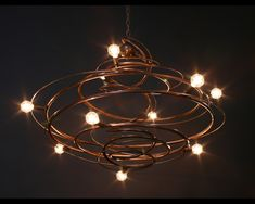 """This antique bronze classic Bodner chandelier piece is perfect for for a  variety of applications, it is a stunning light sculpture whichgives  excellent ambient lighting. UL listed for use with 9 incandescent or LED  lamps it is 30""""x30""""x14""""ht."""