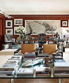 A Woodrow Blagg graphite drawing hangs behind a #RLHome desk and pair of Carbon Fiber RL-CF1 chairs in Ralph Lauren's Madison Avenue office. : @bjornwallander for @archdigest.