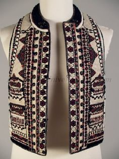 """1927 Romanian [Princess Ileana of Romania Collection] Ivory sheepskin vest (peiptar) with predominantly black and red embroidery. Transylvania region of Romanian, inscribed """"Jacob Luca 1927."""" Sheep skin ground, black leather trim, black wool trim to imitate Persian lamb, plain black buttons, decorated black buttons with painted gold flowers, wool braid and thread. Embroidery types: stem stitch, buttonhole stitch, herringbone stitch, back stitch, couching work."""
