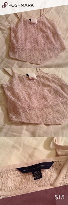 ❤️AEO Tank Top❤️ New with tags. Size xs. AEO light pink see through tank top, can have a bandeau under or use as a swim cover up American Eagle Outfitters Tops Tank Tops
