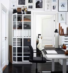 Sticking to black and white colours and natural materials like wood to give a classic, established look to your home office.