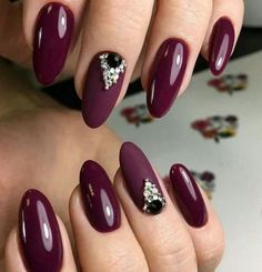 Dark berry polish with accent matte and bling on almond shaped nails