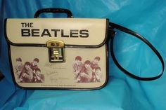 THE BEATLES 1964 NEMS ENTERPISES  VINYL SCHOOL BAG, MADE BY  BURNEL LTD OF CANADA. SELLS @ AUCTION FOR $4K CLICK ON THE PHOTO TO FOLLOW ME ON TWITTER FOR DAILY UPDATES & TRENDS ON ALL THINGS COLLECTIBLE
