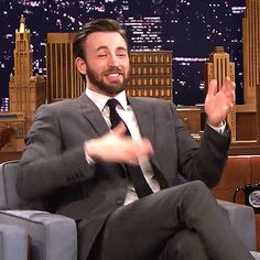 He does the most adorable dorky things with his arms. | 29 Times Chris Evans Ruined You For Other Men