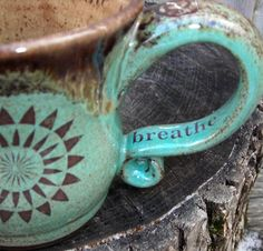 beautiful coffee cup...love the color and the reminder to breathe.....we all need that reminder.