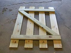 Wood fence gate after diagonal brace cut to length.