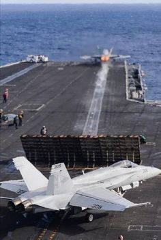 """An Hornet assigned to the """"Blue Diamonds"""" of Strike Fighter Squadron (VFA) 146 launches from the aircraft carrier USS Nimitz (CVN Military Jets, Military Aircraft, Fighter Aircraft, Fighter Jets, Fixed Wing Aircraft, Uss Nimitz, Navy Aircraft Carrier, Go Navy, Flight Deck"""