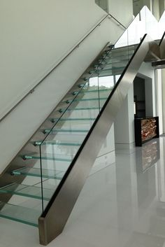 """This is the """"stairway to heaven"""" ..but it's close! Glass stairs have a dramatic impact on a contemporary interior design. Learn about 7 cool uses of glass in this article - http://blog.innovatebuildingsolutions.com/2015/06/06/7-cool-glass-contemporary-luxury-home/"""