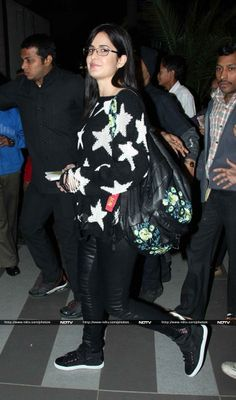 Pics - Happy to be home: Bespectacled Katrina with mother http://ndtv.in/KVQPh2