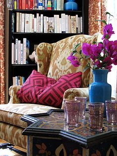 Love this mix - Laura Ashley for Kravet Ikat fabric on chair, pillow David Hicks