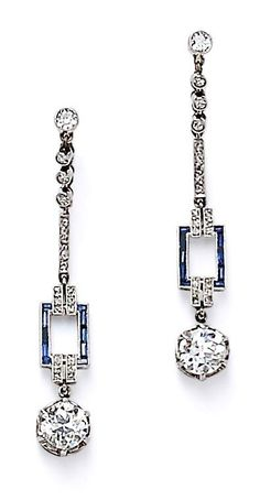 Art Deco Platinum and Diamond Earpendants, each with a transitional-cut diamond drop weighing approx. 0.60 cts., and suspended from full-, single-, and rose-cut diamonds, blue stone accents, lg.