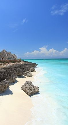Family-friendly resort with thatch-roofed suites and a vast infinity pool overlooking Zanzibar's coral-fringed coast.