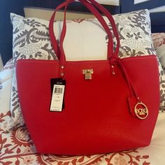 BCBG ♥️ TOTE & CROSSBODY IN RED NWT! Beautiful tote and crossbody bag with gold hardware. Sold as a set! Reasonable offers considered ♥️  - Details below -  Manufacturer: BCBG Paris Orig: $168.00 Condition: New with tags Style Type: Tote Handbag Closure: Twist Lock Bag Height: 18 Inches Bag Width: 12 1/2 Inches Bag Depth: 3 Inches Strap Drop: 10 1/2 Inches Material: Polyurethane/Polyester Fabric Type: Faux Leather Specialty: Lined Color: Red/Cream Size: Large  Crossbody Handbag with…
