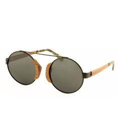 Kutu sunglasses are hand crafted from wood and metal in unique retro styling. The comfort of wood is enhanced with spring hinges and TAC polarised lenses