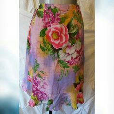 NWOT silk floral skirt NWOT silk floral skirt Excellent condition no flaws  Measurements laying flat Waist 14in Length 24in  Material content 100% silk Diane Gilman Skirts