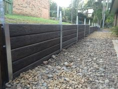 Ridgi Timber-look Concrete Sleeper & Steel Gal Post Retaining Walls by Aussie Concrete Products. For more information visit www.ridgi.com.au