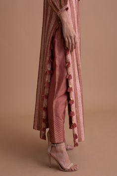 Editor's Note This set features a borrowing from Marrakech'sall-red skyline, this two-toned rust, and blush pink striped silk chanderi kurta features a gypsy-inspired embroidered yoke with zardozi dabka, sitara, cutdana, beadwork, and coin edging. The tassels on the slit and matching rust silk chanderi pants make it ideal fora festive dinner. Fabric: Silk Chanderi Color: Dusty Rust Care: Dry Clean Only Customize Your Outfit Can't find the size you're looking for? No stress. Just select the size Salwar Designs, Kurti Neck Designs, Kurta Designs Women, Kurti Designs Party Wear, Pakistani Dresses Casual, Indian Fashion Dresses, Pakistani Dress Design, Indian Designer Outfits, Stylish Dresses For Girls