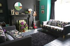 love the turquoise, black walls and black shag rug.