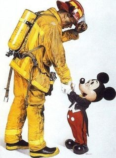 457dfd08b4 Mickey shaking hands with a firefighter.