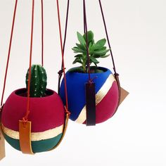 Our hand painted ceramic planters hang in a hand cut leather sling, which can be hung against a wall, from the ceiling or in front of a sunny window. Diy Crafts For Home Decor, Diy Arts And Crafts, Flower Pot Crafts, Flower Pots, Planter Box Designs, Mason Jar Garden, Fairy Garden Plants, Cement Crafts, Hanging Pots