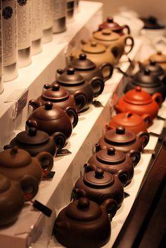 Gong Fu Cha teapots! Exquisite!  rows of teapots at MingCha tea house, hong kong