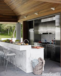 In designer Bonnie Edelman's Ridgewood, Connecticut house, the pool kitchen's stained white-oak ceiling pours warmth over cool metal custom stainless-steel cabinets. A drop-down metal gate protects appliances from rain.   - HouseBeautiful.com Outdoor Kitchen Cabinets, Rustic Outdoor Kitchens, Simple Outdoor Kitchen, Outdoor Kitchen Design, Refinish Kitchen Cabinets, Kitchen Island, Patio Kitchen, Kitchen Decor, Kitchen Modern