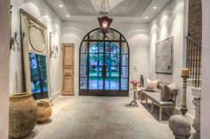 Gallery Feel entry with antique French wood lantern, fresco ceiling, plaster walls.
