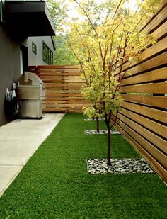 Square metal edging around trees w/gravel, amazing fence