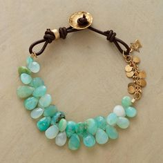 """PERUVIAN STREAM BRACELET--Leather and 14kt vermeil accentuate the watery hues of Naomi Herndon's stream of Peruvian opals. 14kt vermeil button closure. Handmade in USA. 7-1/2""""L."""