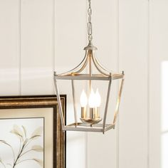 2 of these for over the Island.  Found it at Wayfair - Stanton 3 Light Foyer Pendant