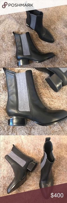 Alexander Wang Black Anouck Ankle Boots Sz 38 8 These Alexander Wang Anouck Boots are brand new without the box or tags. They are a black leather color with a grey stretch fabric on the sides. They have the signature cutout on the heel with silver details. Let me know if you have any questions. They are a size 38 or US 8 Alexander Wang Shoes Ankle Boots & Booties