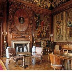 The state drawing room at Chatsworth House with the Duke of Devonshire's portrait, Delft pyramid vases and Mortlake tapestries.