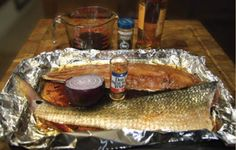 Grilled Redfish on the Half Shell.  1 Redfish on the Half Shell.  1 cup of oil. 3 whole cloves.  1/2 cup of soy sauce.  1T minced onion.   3 oz. whiskey.     Mix marinade. Place redfish flesh side down in a ziplock bag. Marinate for at least one hour. Clean and prep the grill with an onion. Sear the flesh side of the fish for a couple of minutes and then turn the fillets over to cook an additional 15 minutes.