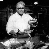 Charlie Vergos sprinkles some dry rub seasoning of some of the Rendezous' famous ribs in June, 1983. The founder of the iconic Downtown Memphis barbecue restaurant that bears his name, died Saturday, March 27, 2010.
