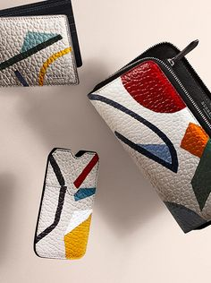 Vibrant, hand-painted prints on new season Burberry leather wallets