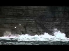 Jump into Ireland - Al Mennie surfs the Cliffs of Moher - Tourism Ireland