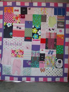 Pretty pinks and lavenders for this baby clothes quilt