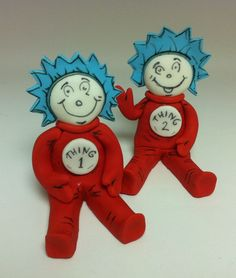 Dr Seuss and fish cake toppers, thing 1 and thing 2 joined by a yellow fish