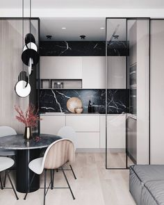 contemporary kitchen A small kitchen is separated from the living room dining room combo by a set of Interior Modern, Home Interior, Kitchen Interior, Kitchen Decor, Diy Kitchen, Kitchen Layout, Kitchen Living, Kitchen Ideas, Kitchen Counters