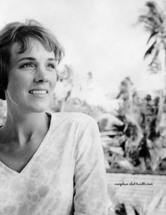Julie Andrews sports a delightfully fresh and uncomplicated short haircut.