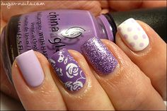 Mix n Match Purple... Pointer: China Glaze Snow, dotted with OPI Rumple's Wiggin; Middle: 2 generous coats of Nubar Hyacynth Sparkle; Ring: China Glaze Spontaneous, roses stamped with Konad M65 and white Special polish; Pinky: OPI Rumple's Wiggin. (Thumb just two coats of China Glaze Spontaneous.)   From Sweet Sugar