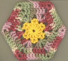 The Fiori Esagono - Flower Hexagon will have you saying ciao bella while you crochet. Feel a very Italian vibe from this crochet hexagon by crocheting in muted tones and variegated yarn. The small flower crochet center is what makes this crochet hexagon pattern so eccellente.