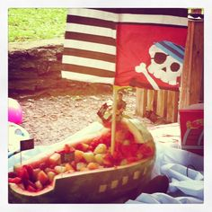 So my mom-who's so new to pinterest that she doesn't know how to pin or repin-comes up with this awesome idea to pit out a watermelon and create a pirate ship (via pumpkin carvers) and then fill said ship w the mixed fruit for a pirate themed kids party! Awesome?! Why yes it was!!