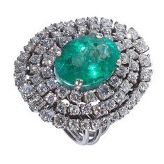 Emerald Diamond White Gold Cluster Ring | From a unique collection of vintage cluster rings at https://www.1stdibs.com/jewelry/rings/cluster-rings/