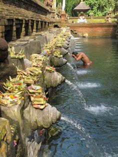 Visit Tirta Empul, a beautiful Bali temple where Balinese come to take a bath in the holy springs.
