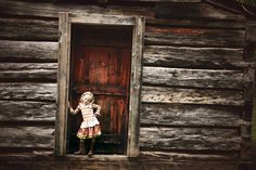 Shabby chic, vintage rustic outdoor photo session. Classy ideas for very unique youth photos. Little girl toddler birthday pictures. Umbrella, wingtips, cupcake, pink, black and white, pom poms, cabin, vintage suitcase, boots props. Photos that are different and unique for little girl youth birthday pictures. Smash cake ideas. Lauren Davidson photography.