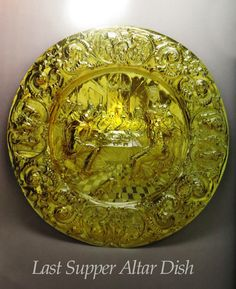"ENGLISH ROYAL PLATE: THE ""LAST SUPPER"" ALTAR DISH, 1664. Made for James, Duke of York, by Henry Greenway, this extraordinary dish depicts Christ dining with the twelve Disciples. Ornate plate with figurative imagery came to have a special importance in English churches after the Reformation."