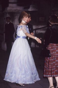 The Prince and Princess of Wales attend a gala recital evening at the Victoria and Albert Museum in London November 1981 She is wearing a dress by...