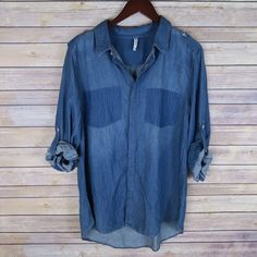 Dark blue button down shirt Brand:Leshop Size:L (best fit M) junior size New(no tags)   3/4 sleeves with button tabs  Dark pocket patches  Collared neck  Button closure on front  60% Cotton 40% Tencel Tops Button Down Shirts