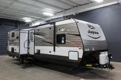 """QUALITY FAMILY TIME AWAITS!!!  2017 Jayco Jay Flight 33RBTS There's something for everyone in this RV! The kiddos will love the awesome bunkhouse, and you'll love spending time getting fresh air! Cook at your outdoor kitchen and relax under the enormous 20' awning! This great RV sleeps a whopping 9 people and is 37' 8"""" long and weighs 8,310 lbs. Give our Jay Flight expert Ryan Madden a call 616-215-0435 for pricing and more information!"""